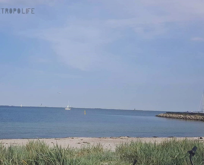 Amager Beach with planes and boats in the background